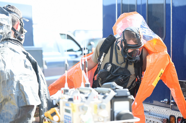 Pfc. Billy Newman, survey team member with the 84th Civil Support Team,  donning his chemical suit in preparation for their training lane exercise.